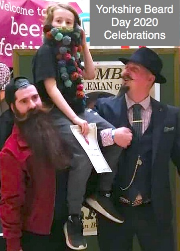 Shane Hazelgrave the gent in red with the big beard and impressively curled moustache is crowned Yorkshire Beard of the Year 2020 - here he celebrates with fellow fun and friendly Beard competitors McPiggleface and Ben Waddington.